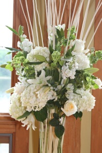 Tall arrangement filled with bleached branches, white and green flowers and foliages - always a favorite combo for me.