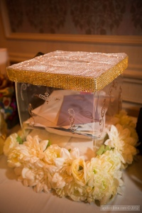 Our sparkly glass money box.