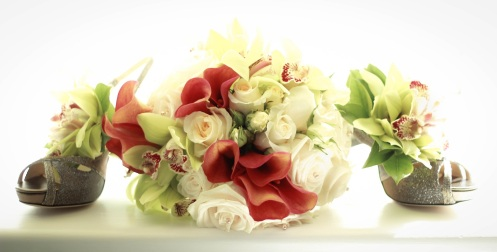 Gorgeous Hand-tied bouquet of roses, calla lilies and orchids