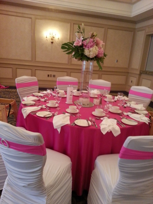 "White ""Sophisticate"" Chair covers with hot pink bands"