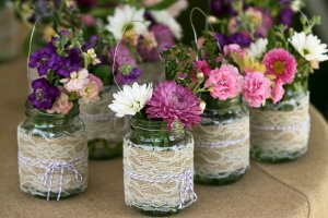 Burlap and lace Mason jars, found on www.onewed.com