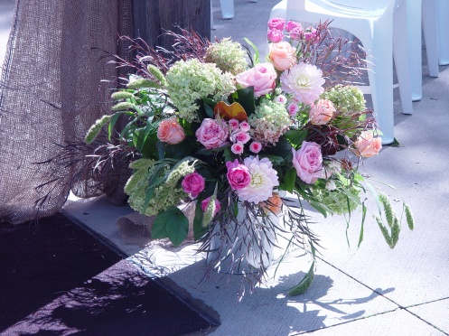 Beautiful garden arrangements with roses, hydrangeas...in a large pail.