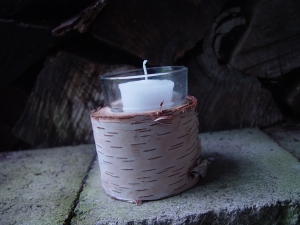 Votive holder carved from birch.