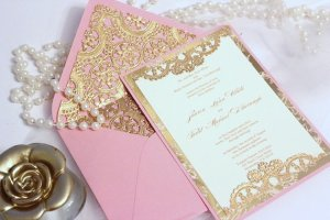 Rich, detailed gold and pink invitation found on Etsy